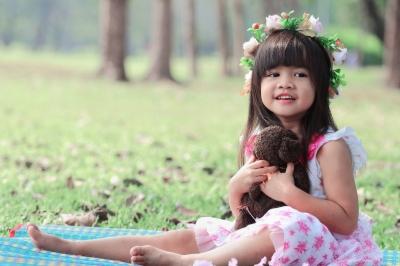 Cute little girl outside in a park