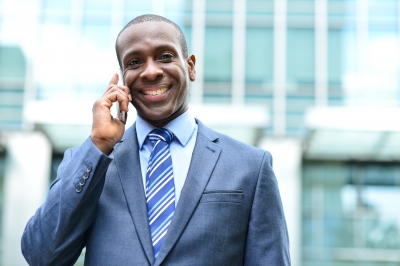 Smiling man talking on a cell phone